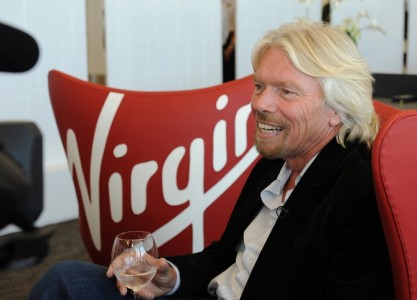 """In this photo released by Virgin America Airlines, Sir Richard Branson relaxes at the new sustainable Terminal Two (T2) at San Francisco International Airport, April 6, 2011 in San Francisco., The Terminal is slated to be the first LEED ® Gold-certified terminal in the U.S. and offers features intended to improve the typical airport experience, like a stress-free """"Recompose"""" lounge post-security, free wireless and plugs throughout, living room-like gate spaces and """"moodlighting"""" that reflects Virgin America's own signature cabin lighting.  The only airline headquartered at SFO, Virgin America's growth stimulated the project and informed the T2 design process from the earliest stages.  The airline will be an anchor tenant at SFO's T2.  (HANDOUT Photo/Virgin America Airlines, Bob Riha, Jr.)  *No Sales*"""